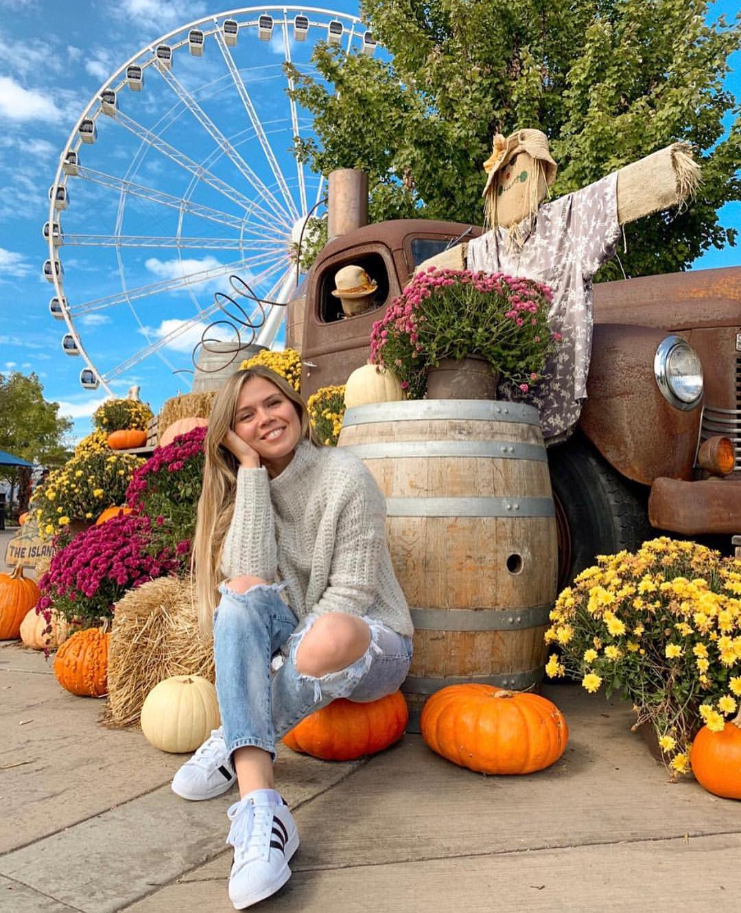 girl in sweater with fall decorations